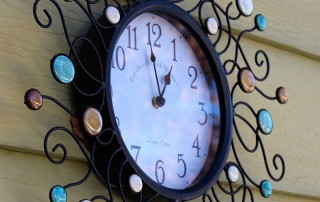 wrought iron clock with colored stones