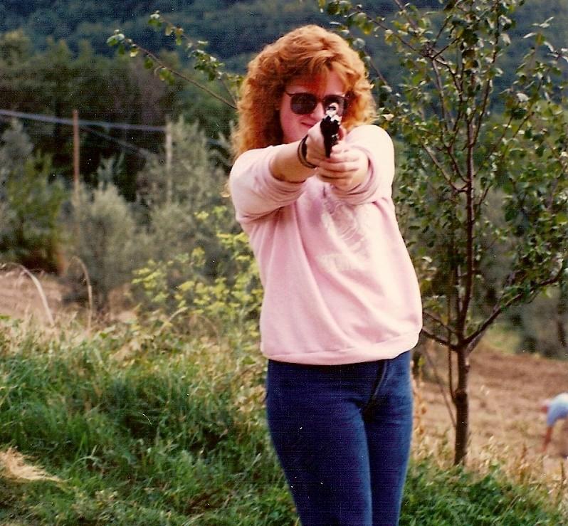 redhead with a gun, redhead woman pointing a gun
