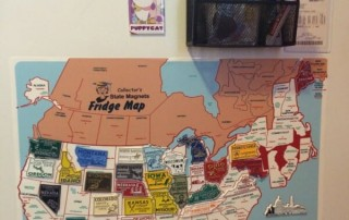 state magnets and map on the fridge
